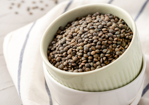 RL - French green lentils in a bowl on the table