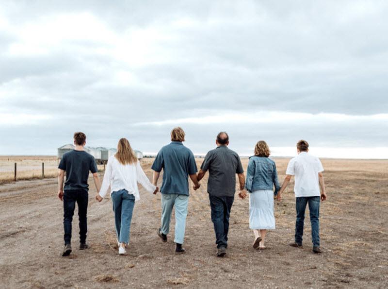 Rosevale - Rosevale family holding each others hands